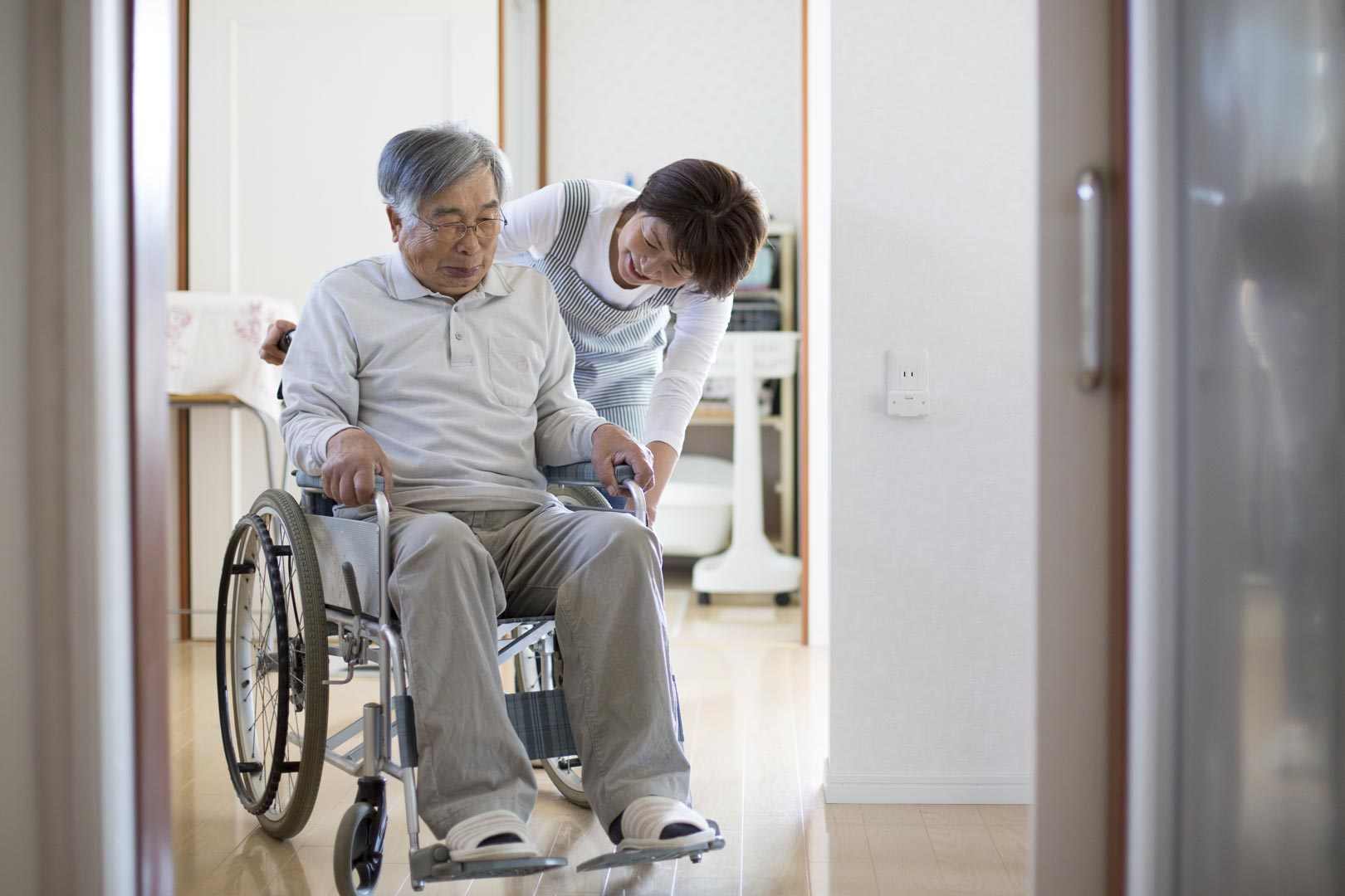 Japanese person in wheelchair with carer