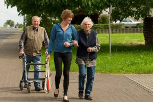 Older people walking withe younger one