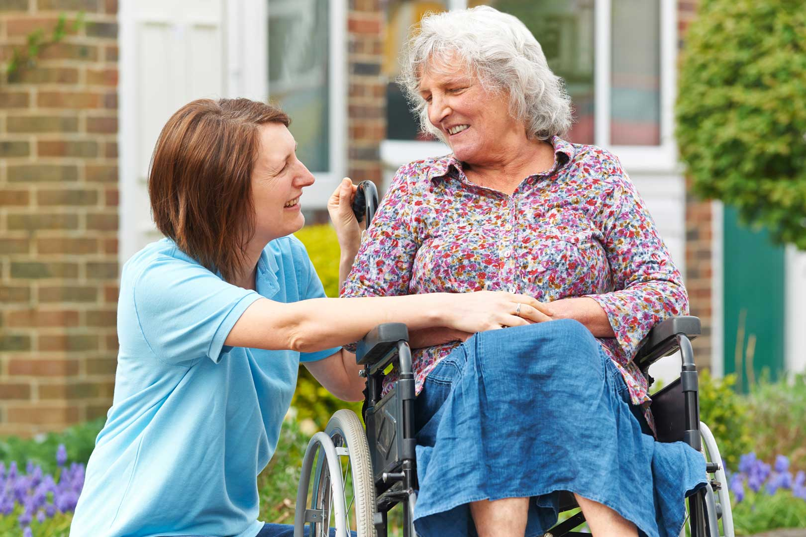 Carer with client - looking at each other
