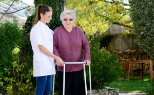 Carer and person with rollator