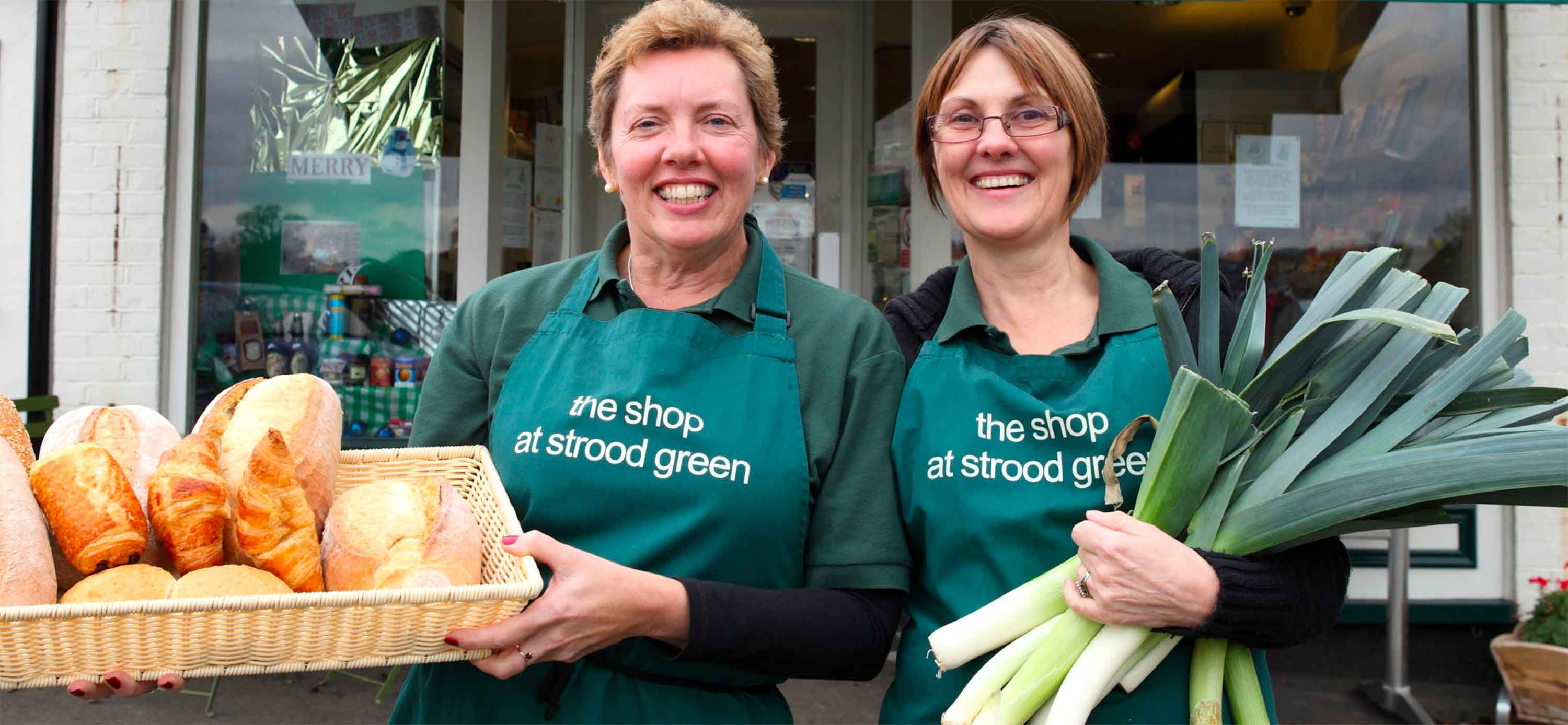 Two shop helpers with fresh produce (Plunkett image)