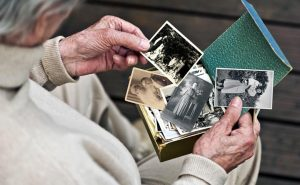 Older person looking at photos from past