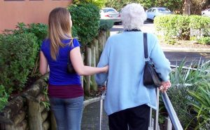 A young carer with an elderly woman