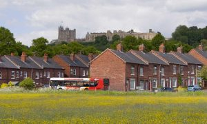 Bus passing houses